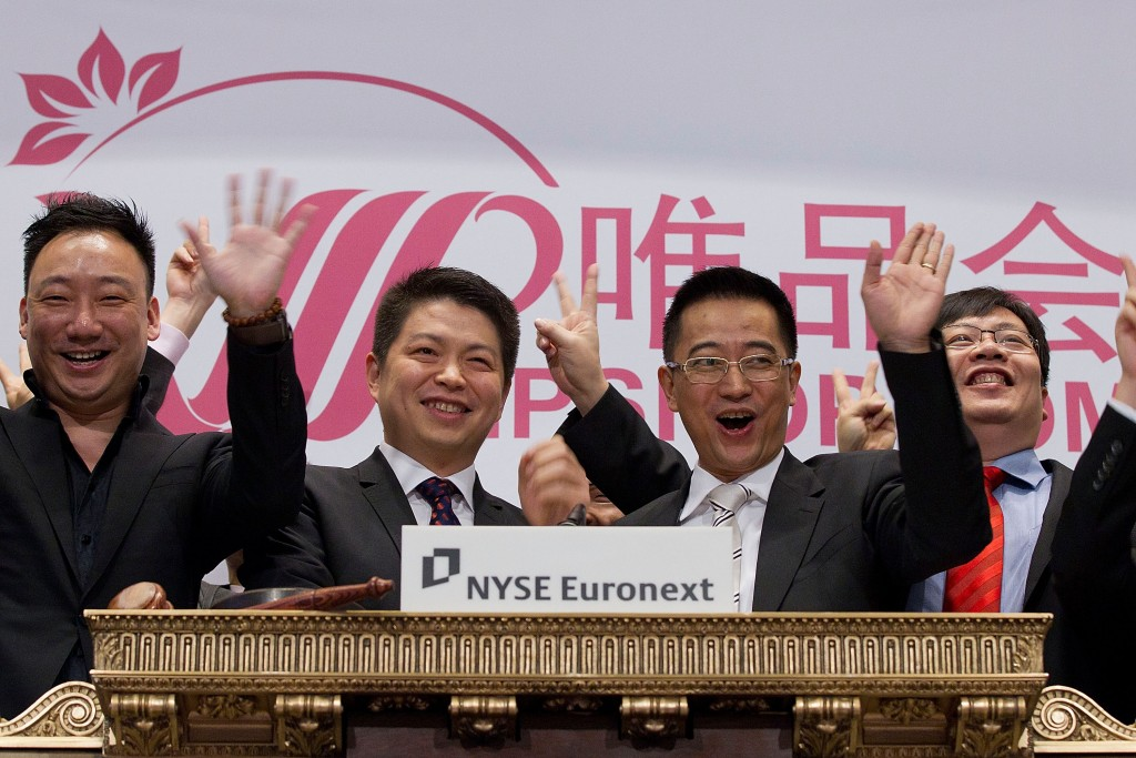 NEW YORK, NY - MARCH 23:   Vipshop's, Eric Shen, Co-Founder and CEO rings the opening bell at the New York Stock Exchange on March 23, 2012 in New York City. (Photo by Ben Hider/NYSE Euronext)