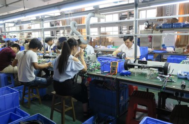 Factory workers at Mr. Lin and his father's factory