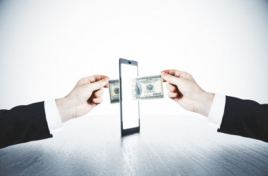 47358983 - money transfer with man hands and digital tablet concept