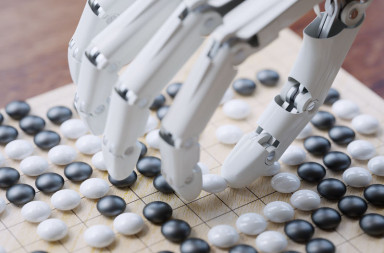 56867166 - artificial intelligence playing traditional board game go concept