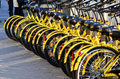 67238677 - beijing,china-december 2016-one row yellow bicycles called ofo shareing bicycle beside the street in beijing of china.
