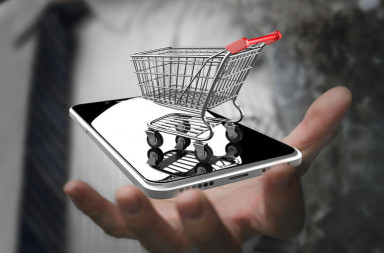 45008462 - businessman hand showing shopping cart with smart phone, on line shopping concept.