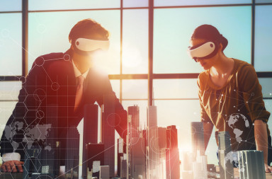 52899644 - two business persons are developing a project using virtual reality goggles. the concept of technologies of the future