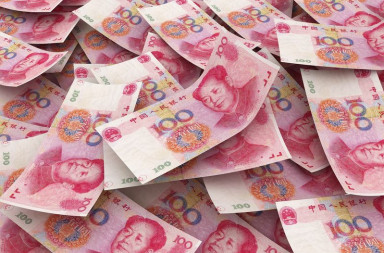 16514273 - chinese 100 yuan bill face within pile of other 100 yuan bills RMB