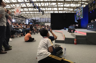 Groups of fans gathered around Honor of Kings' live competition at Mobile World Congress 2017 in Shanghai