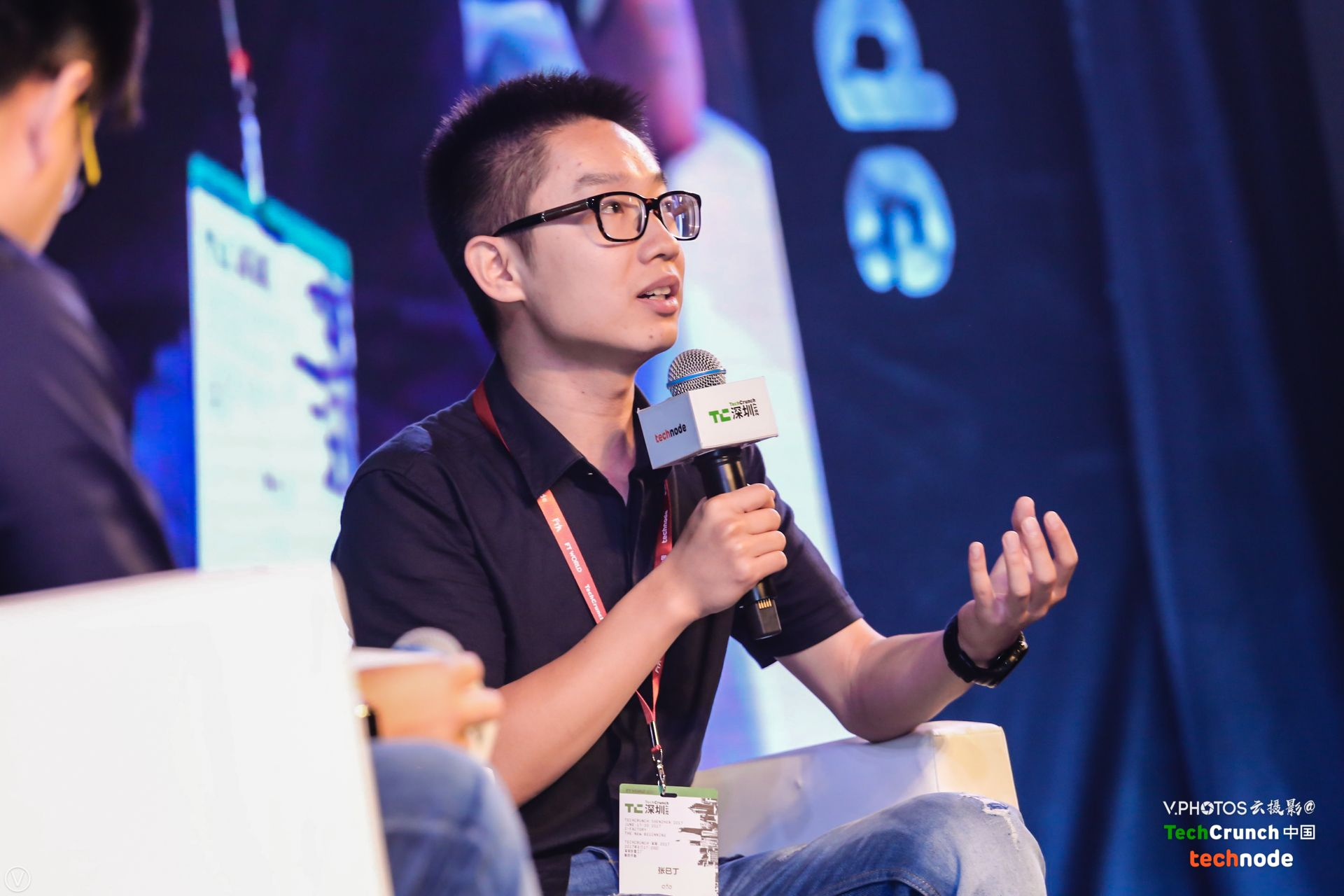 "Ofo's co-founder Austin Zhang speaking at a panel called ""How Does Sharing-economy Push the Development of Credit City?"" at TechCrunch Shenzhen 2017."