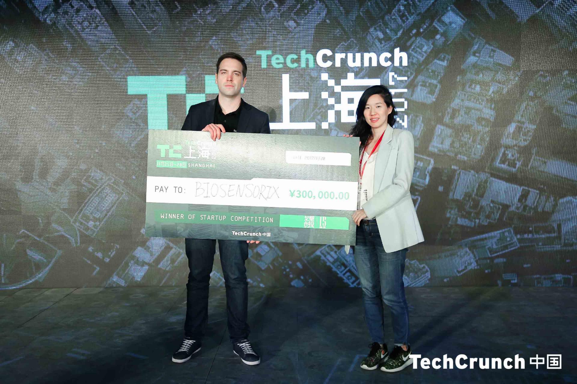 Biosensorix co-founder Luka Fajs receiving his check (Image credit: TechCrunch Shanghai)