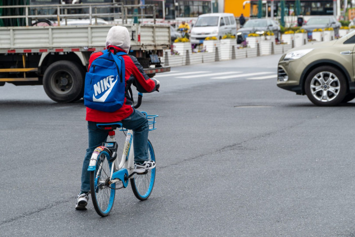 A Hellobike rider waits for traffic on the streets of Shanghai on March 22, 2019.