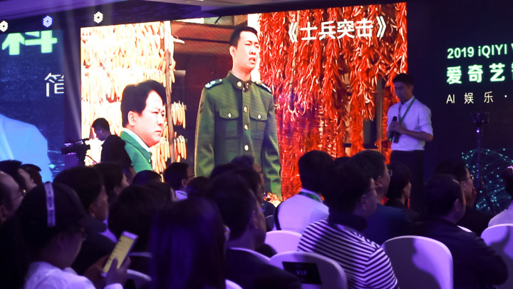 At iQiyi's 2019 World Conference in Beijing May 9, executives demonstrated AI-powered methods to refurbish old movies. (Image credit: TechNode/Cassidy McDonald)